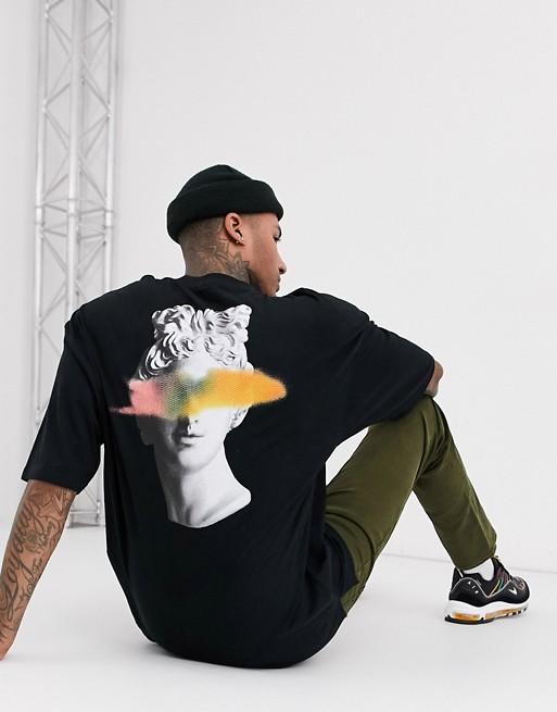 t shirt long look tenue homme streetwear ete 2020 motif logo art abstrait noir statue asos
